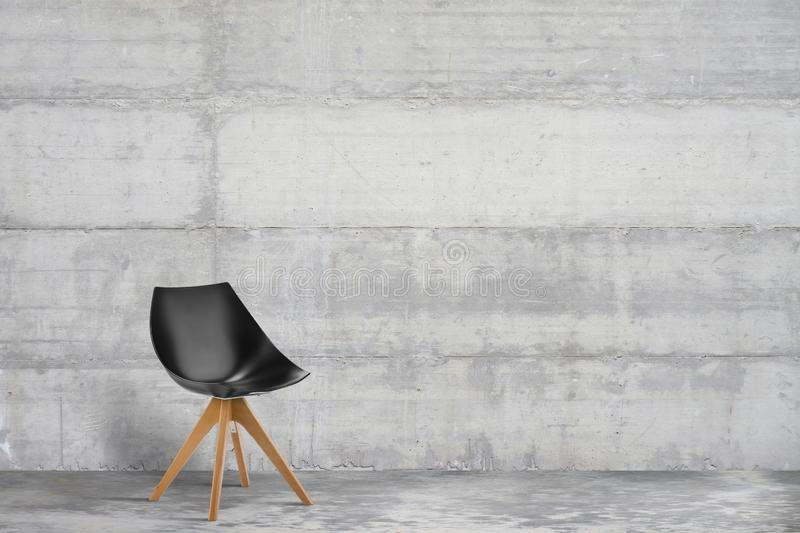 Designer, modern armchair in grey, loft style interior royalty free stock images
