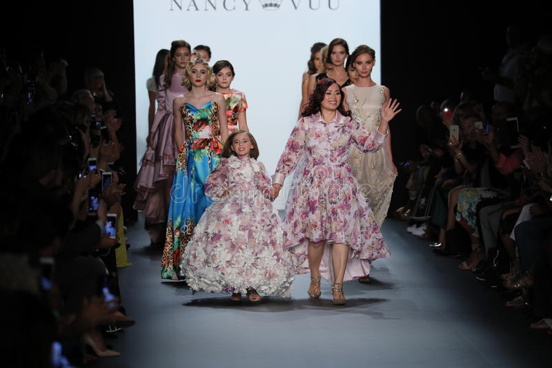 Designer Nancy Vuu and models walk the runway at the Nancy Vuu fashion show. NEW YORK, NY - SEPTEMBER 11: Designer Nancy Vuu and models walk the runway at the stock photo