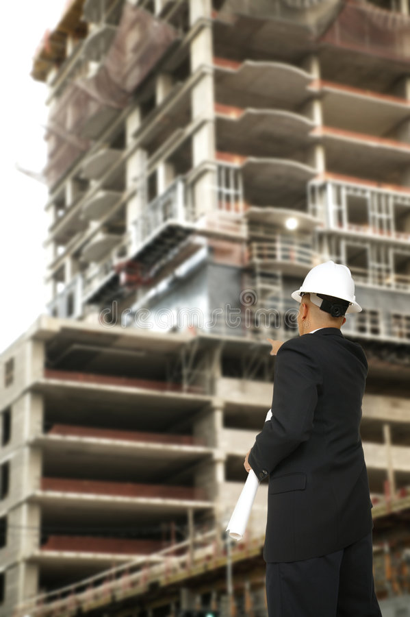 Free Designer Pointing At Building Under Construction Stock Image - 4797981