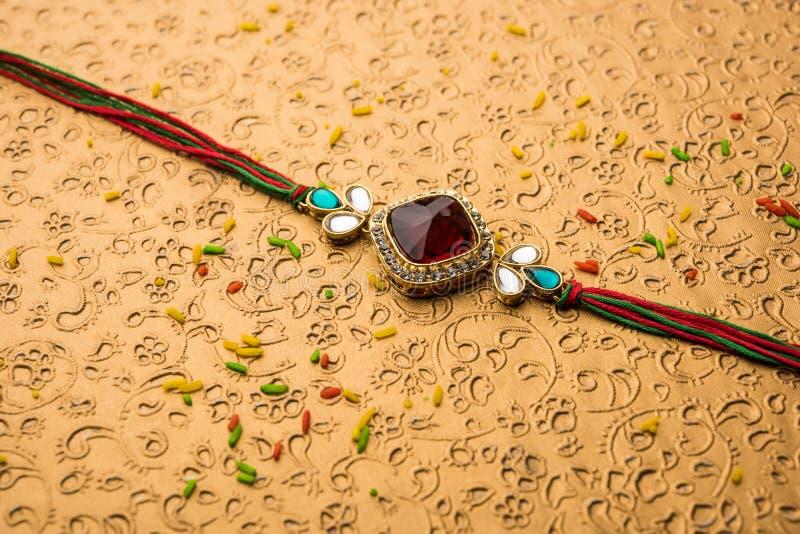 Designer Rakhi or Raakhi or Wristband for Raksha Bandhan festival of India, isolated. Designer Rakhi / Raakhi or Wristband for Indian Festival Raksha Bandhan stock photography