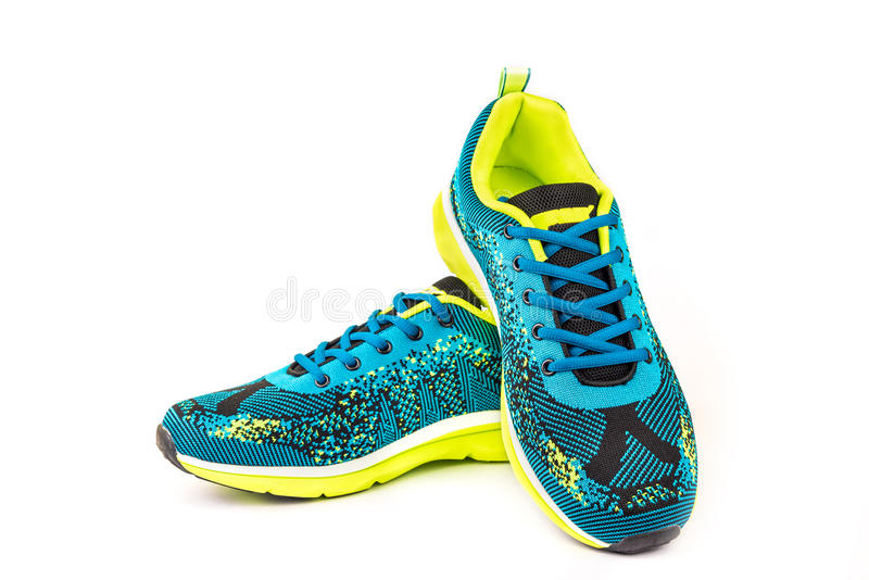 Designer sport shoes. Ergonomic comfortable designer sport shoes in brigh colors over white background royalty free stock images