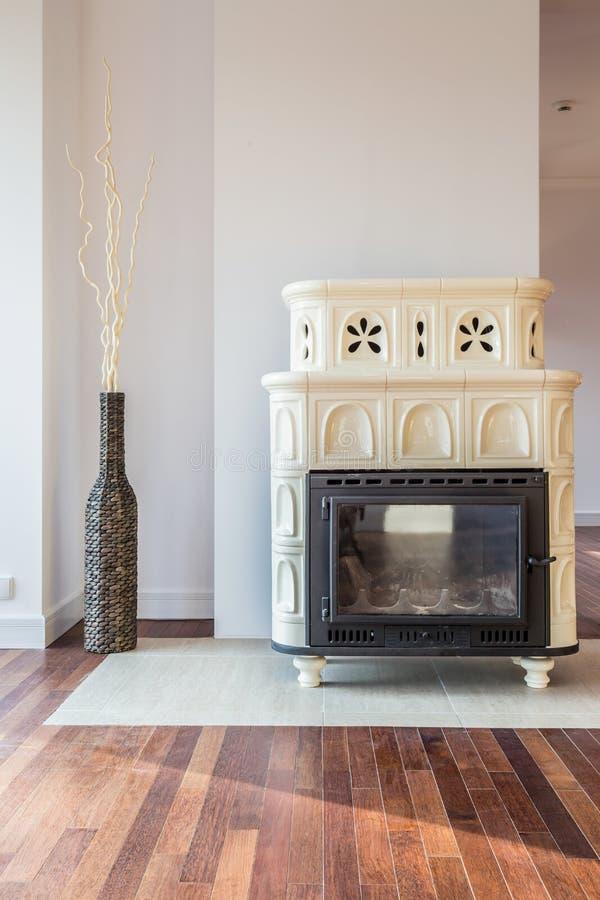 Designer stove in living room royalty free stock photo