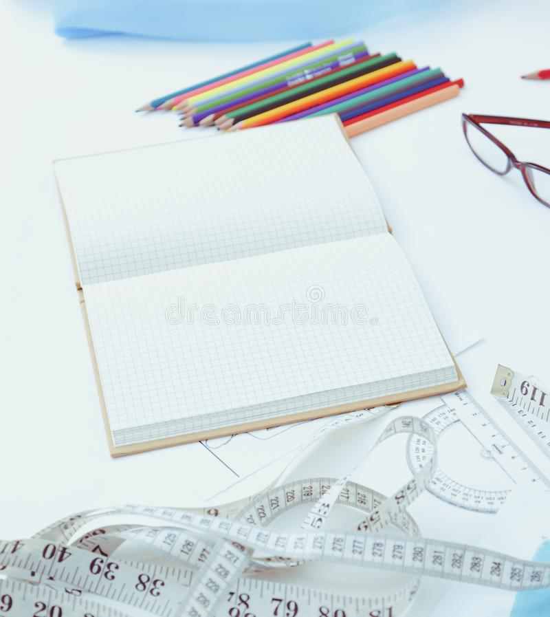 Designer table with blank note and tools.  stock image
