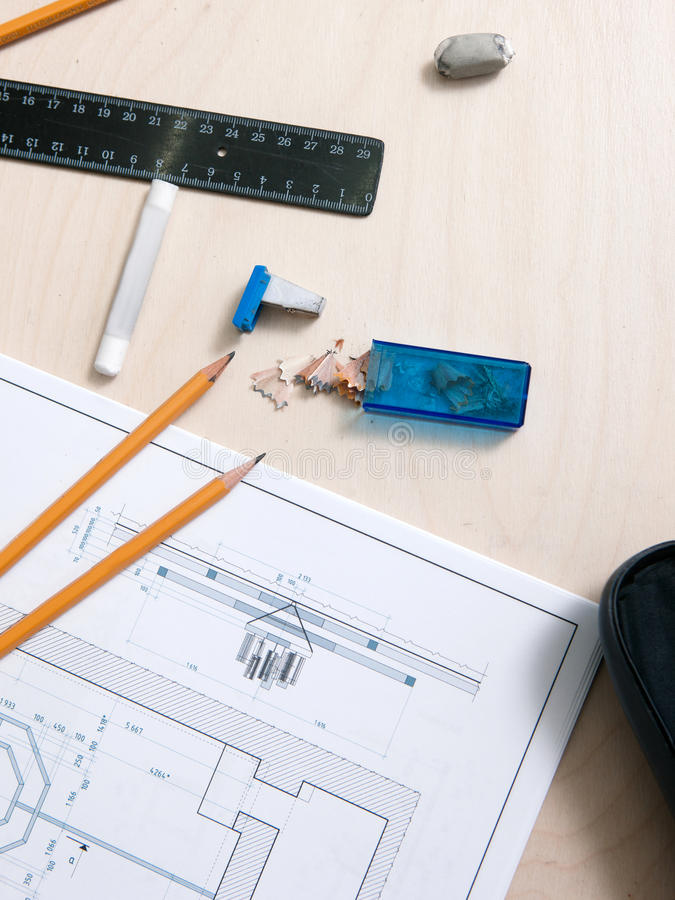 Designer tools on drawing schetch. Architects desk in working process royalty free stock image
