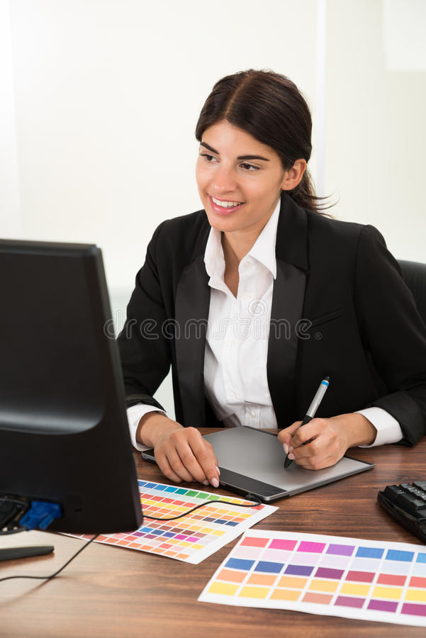 Designer using graphic tablet with color sample royalty free stock photography
