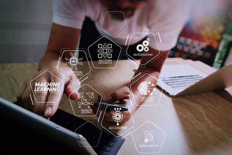 Designer using smart phone and keyboard dock digital tablet with. Machine learning technology diagram with artificial intelligence (AI),neural network,automation stock image