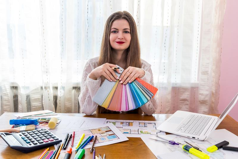 Designer woman working with colour samples, workplace.  royalty free stock image