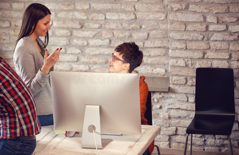 Designer women working using computer on new project royalty free stock image