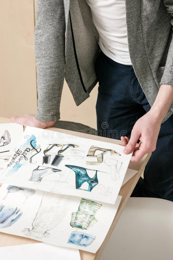 Designer work on fashion sketches stock photography
