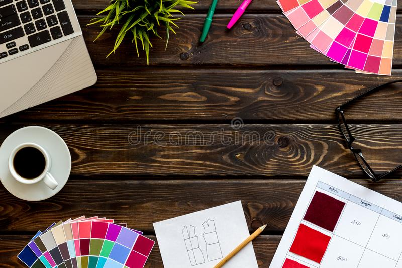 Designer work space with pallet, glasses, laptop and coffee on wooden background top view mockup stock images