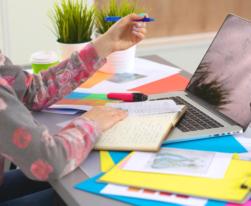 Designer working at desk using digitizer in his office.  royalty free stock photo