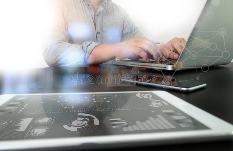 Designer working digital tablet and computer laptop with smart p royalty free stock photography