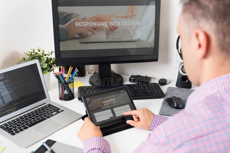 Designer working on responsive web design project stock photography