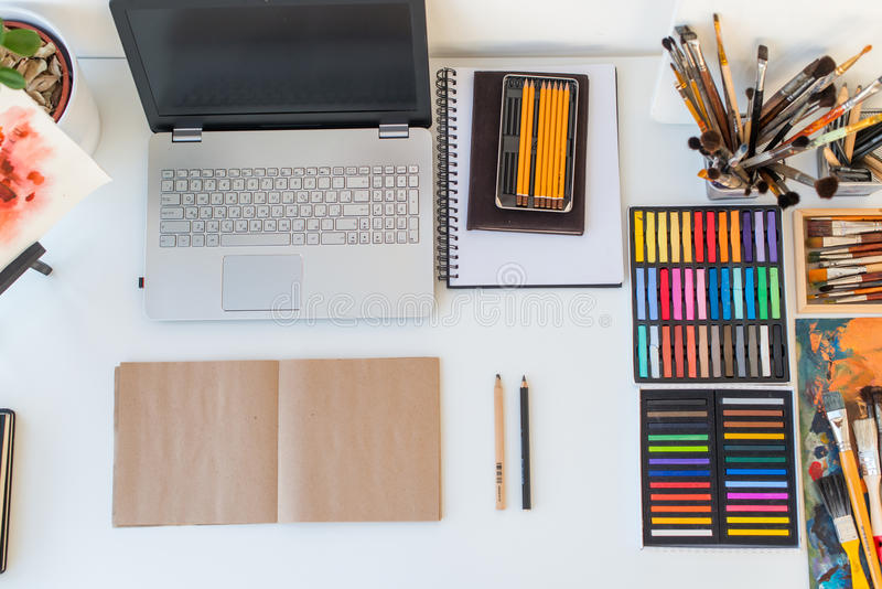 Designer workplace top view. Painter desk with drawing equipment. Home studio for artist. Designer workplace top view. Painter desk with drawing equipment. Home stock photos
