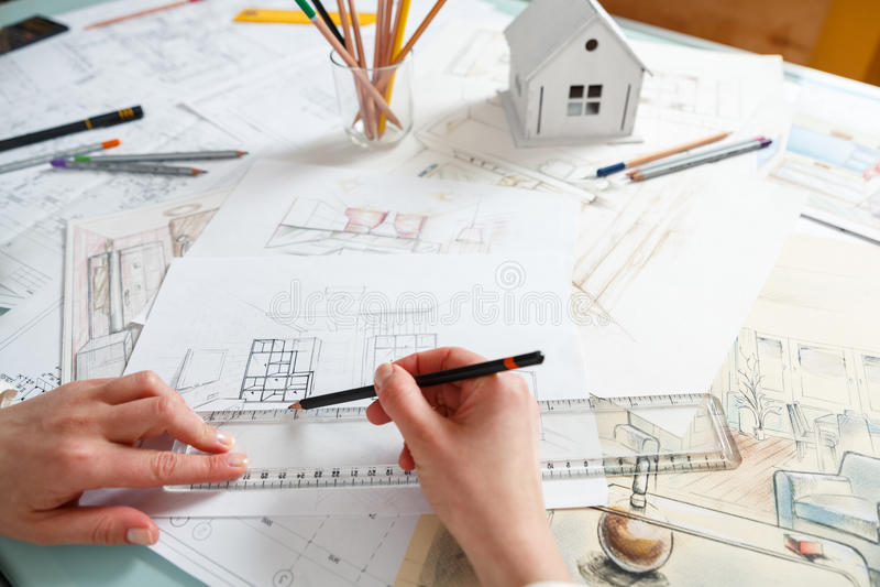 Interior Designer Working: Designer Works With Hand Drawing Of Interior Stock Image