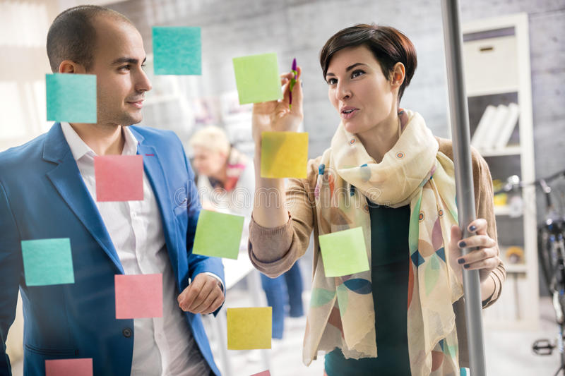 Designers discus about artistic plan at design studio stock photos