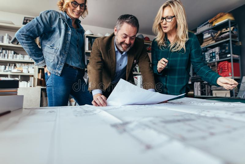 Designers finalize a housing construction plan stock photography