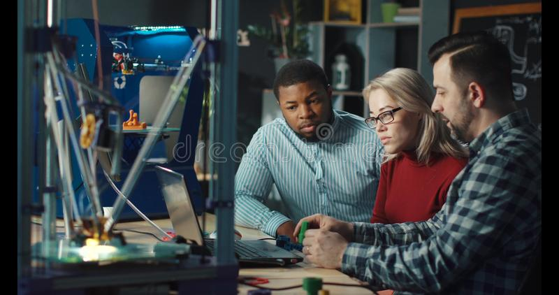 Designers having discussion in engineering lab royalty free stock photography