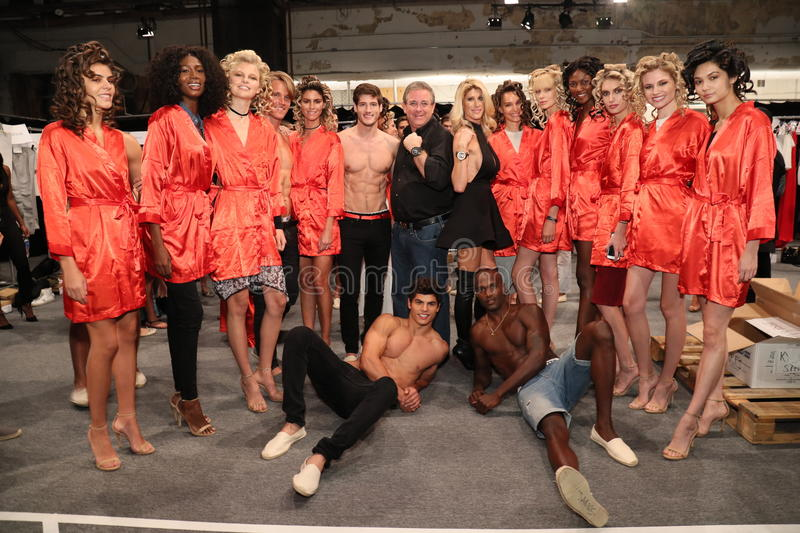 Designers Jenn Taule Bell and Marc Bell and models posing backstage at the KYBOE! fashion show. NEW YORK, NY - SEPTEMBER 10: Designers Jenn Taule Bell and Marc stock images