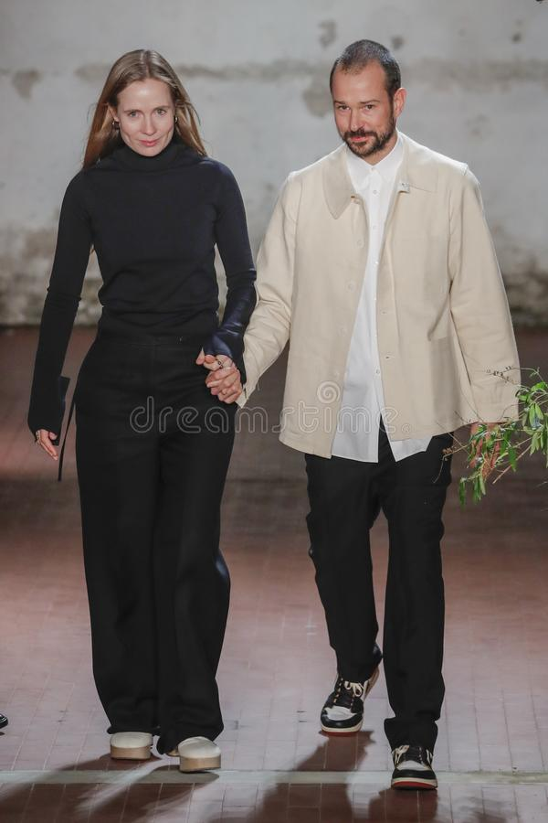 Designers Lucie Meier and Luke Meier walk the runway at the Jil Sander show at Milan Fashion Week. MILAN, ITALY - FEBRUARY 20: Designers Lucie Meier and Luke royalty free stock photos