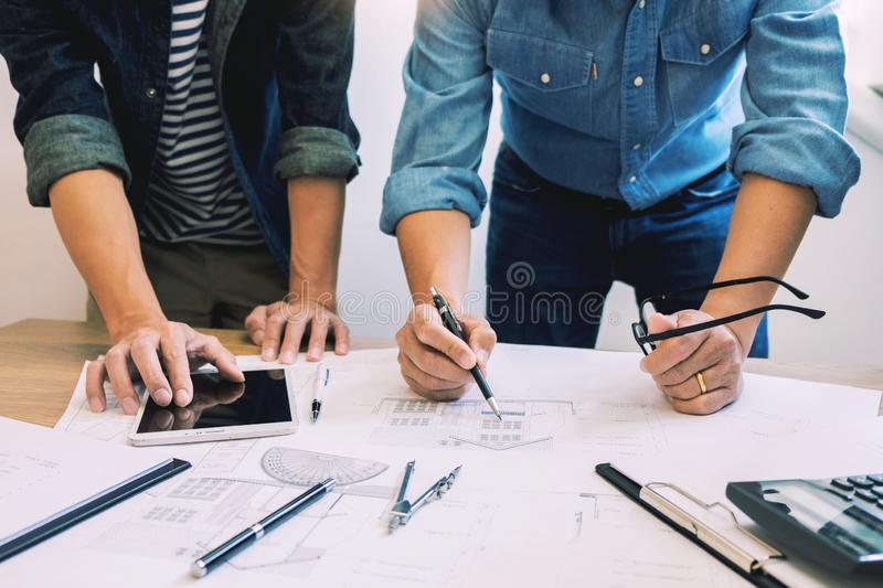 Designers in the office are working Discussion Blueprint Architect on a new project Design Draw Teamwork on wooden desk royalty free stock photo
