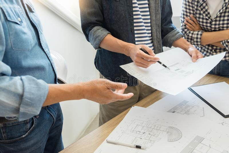 Designers in the office are working Discussion Blueprint Architect on a new project Design Draw Teamwork on wooden desk royalty free stock images