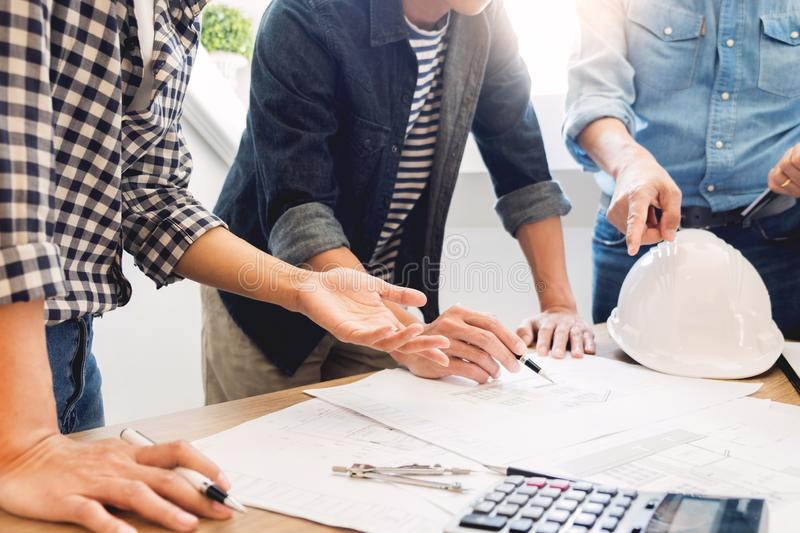 Designers in the office are working Discussion Blueprint Architect on a new project Design Draw Teamwork on wooden desk stock image