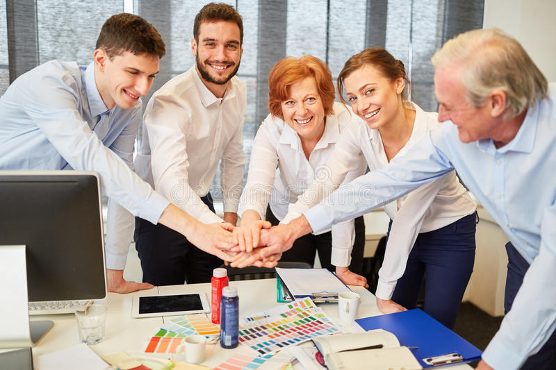 Designers in start-up team stacking hands stock photos