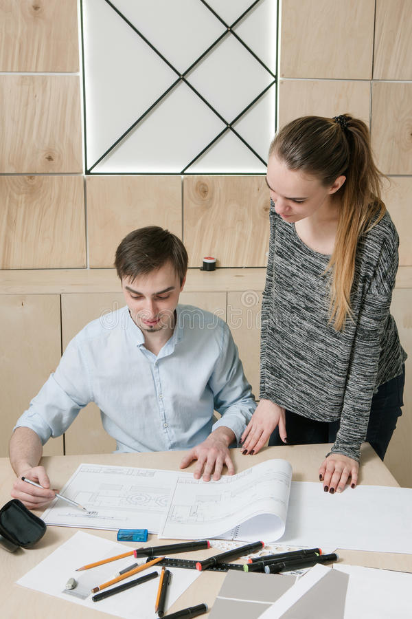Designers teamwork on artistic sketches stock image