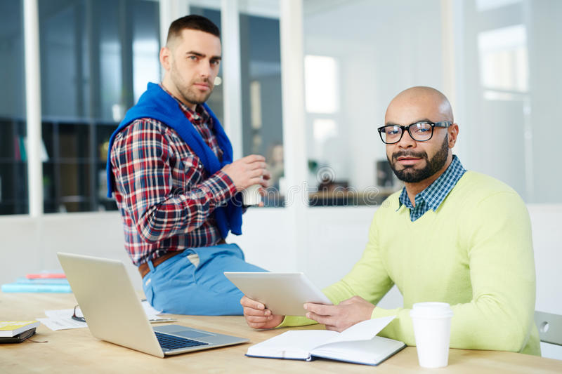 Designers at work. Modern designers working in office royalty free stock photo