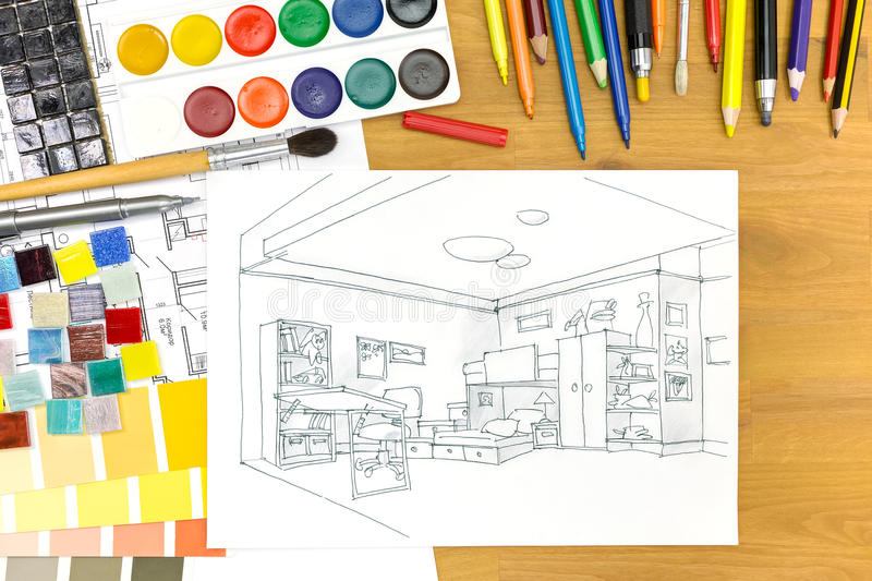 Designers workplace arrangement image. Interior designers desk with architectural tools and a kids room sketch