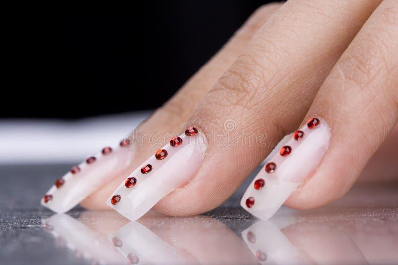 designfingrar manicure original royaltyfri fotografi