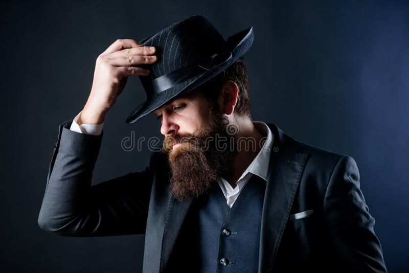 Designing new clothes. Bearded man gentleman. Detective in hat. Mature hipster with beard. Secret shy. Male formal. Fashion. brutal caucasian hipster with royalty free stock photos