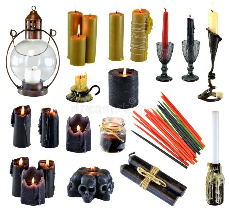 Designuppsättning med att bränna svarta röda och färgrika stearinljus som isoleras på vit arkivfoton