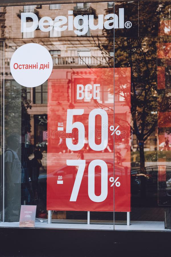 Desigual sale display window on street. Signboard logo brend sign and showcase window of Desigual  store, shop, mall, boutique. Kiev, Ukraine - September 02 royalty free stock image