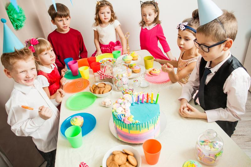 Desire on birthday. Little kids celebrating birthday. The boy blown candles on the cake royalty free stock photo