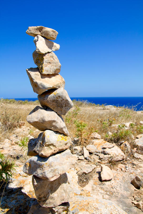 Desire make a wish stacked stones mound. In formentera island royalty free stock photography