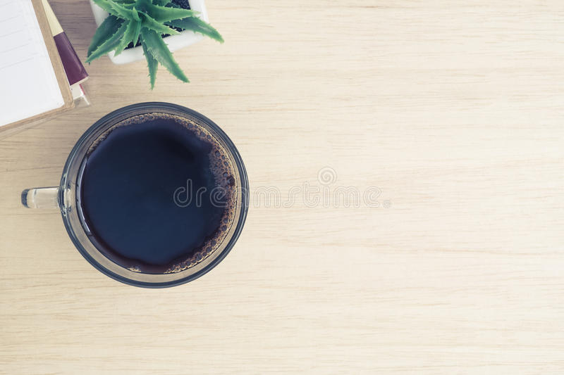 Desk above, table top view of office desk - a cup of hot coffee, stock photo