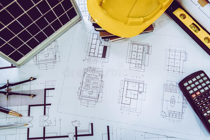 Desk of architects Solar Energy Powered Home Green for reduce global warming. Concept royalty free stock photo