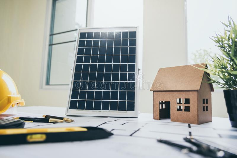 Desk of architects Solar Energy Powered Home Green for reduce global warming. Concept royalty free stock photos