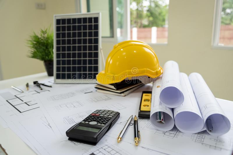 Desk of architects Solar Energy Powered Home Green for reduce global warming. Concept stock photo