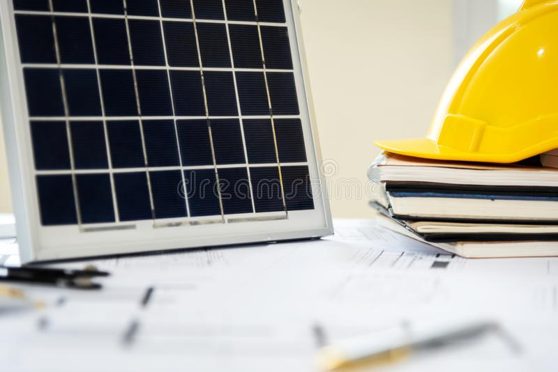 Desk of architects Solar Energy Powered Home Green for reduce global warming. Concept stock photography