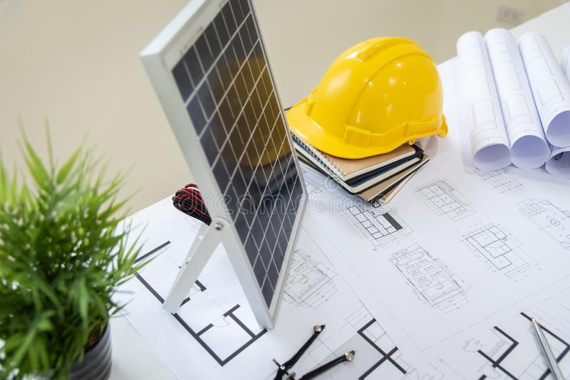 Desk of architects Solar Energy Powered Home Green for reduce global warming. Concept stock photos