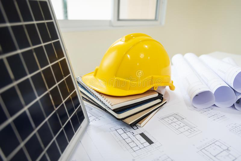 Desk of architects Solar Energy Powered Home Green for reduce global warming. Concept royalty free stock photography