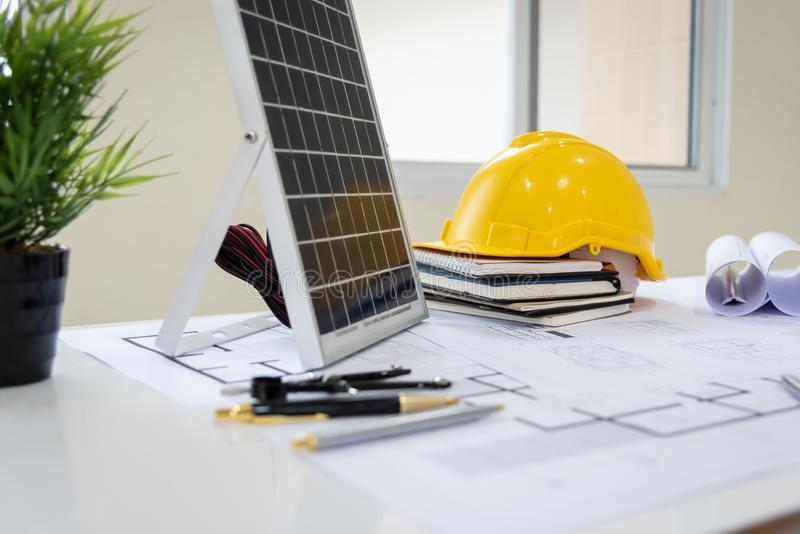 Desk of architects Solar Energy Powered Home Green for reduce global warming. Concept stock image