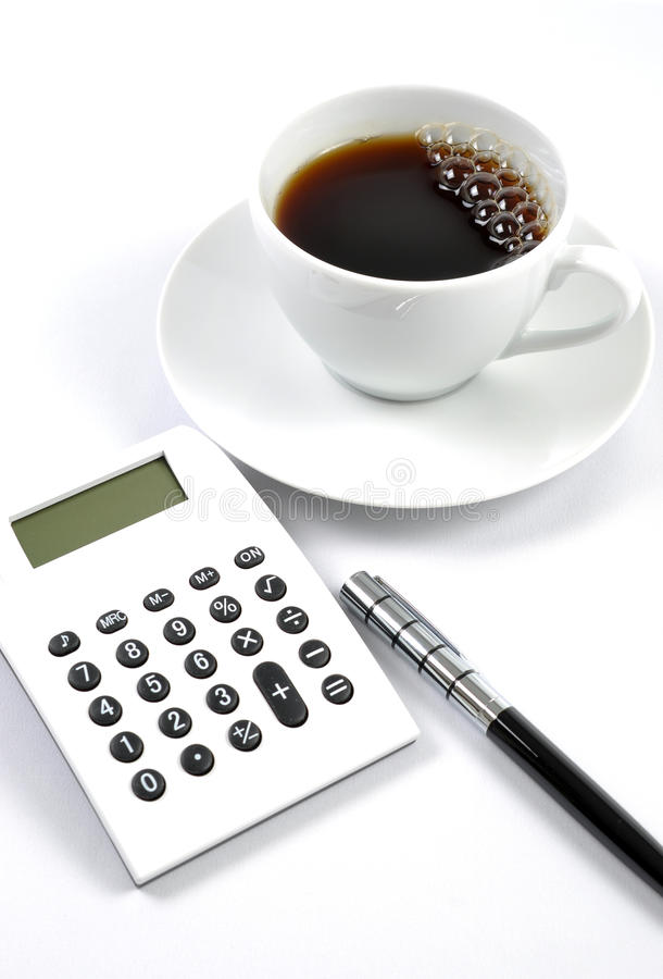 Desk With A Calculator And Pen Royalty Free Stock Image