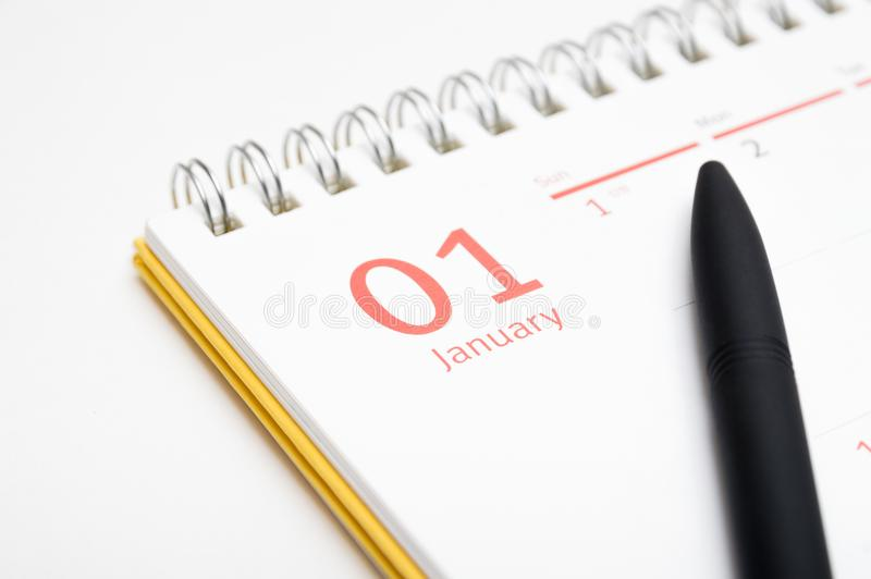 Desk calendar and pen on white background royalty free stock image