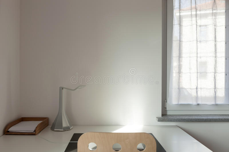 Desk and chair in a room stock photos