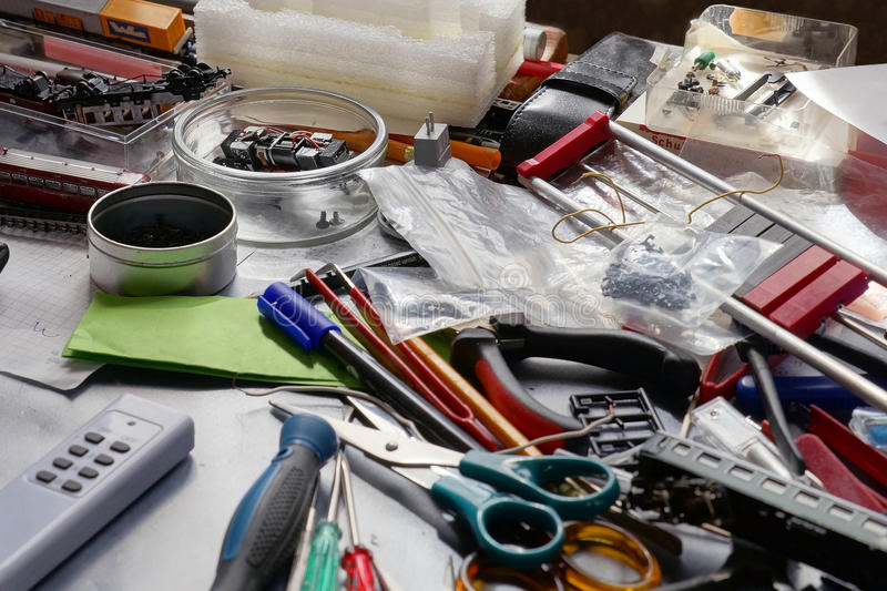 Desk cluttered with tools stock photography