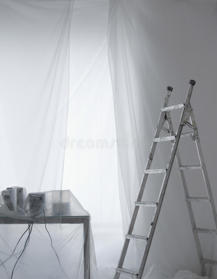 Desk Covered In Transparent Dust Sheets royalty free stock images